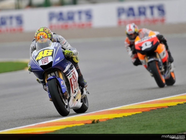 Valentino Rossi riding ahead of Dani Pedrosa action during Practice in Valencia