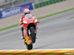 Casey Stoner pulls off a wheelie after QP in Valencia