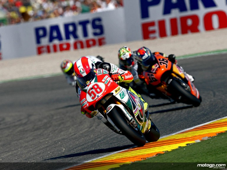 Marco Simoncelli riding ahead of 250cc group in Valencia