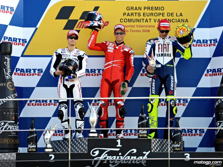 Dani Pedrosa, Casey Stoner and Valentino Rossi on the podium at Valencia (MotoGP)