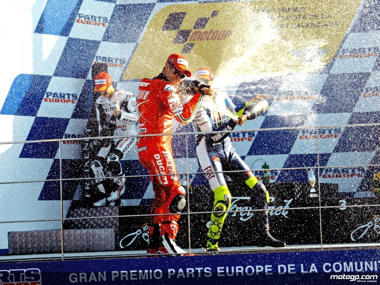 Casey Stoner, Dani Pedrosa and Valentino Rossi celebrate podium in Valencia