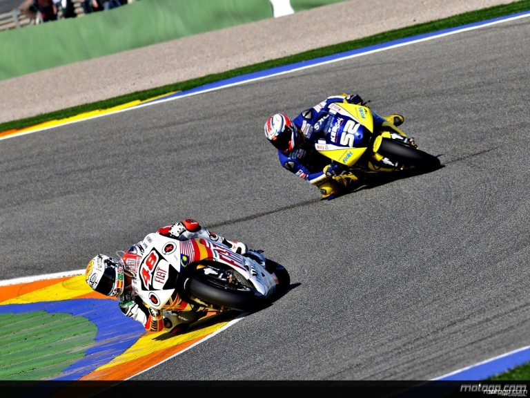 Jorge Lorenzo riding ahead of James Toseland in Valencia (MotoGP)