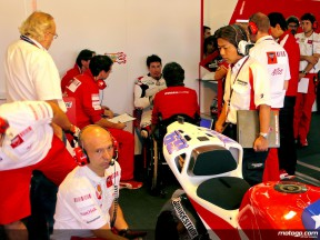 Nicky Hayden with Ducati staff in the garage