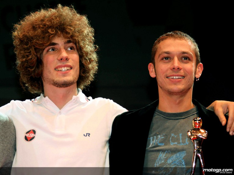 Marco Simoncelli and Valentino Rossi receiving `Golden Helmet´ at Bologna Motorshow
