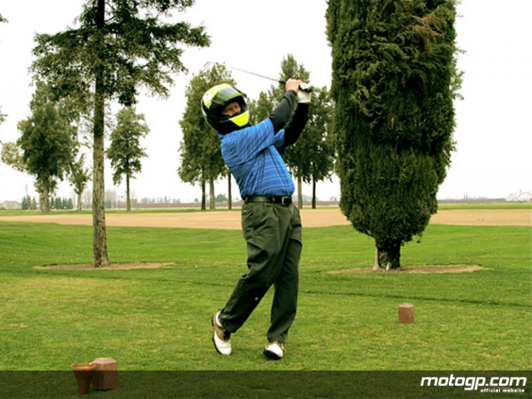 Kenny Roberts practicing swing for charity golf tournament