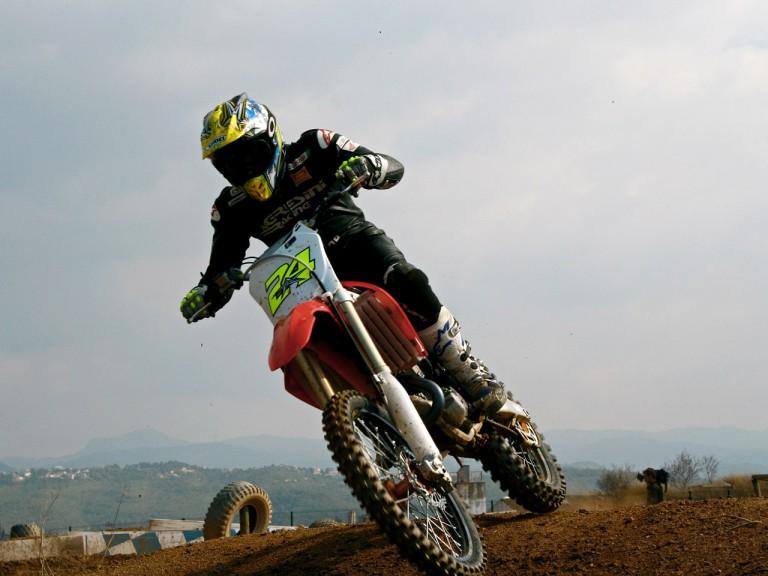 Toni Elias training on Motocross machinery