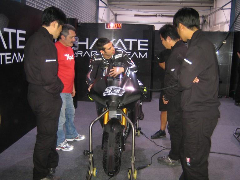 Marco Melandri in the Hayate Racing Team box