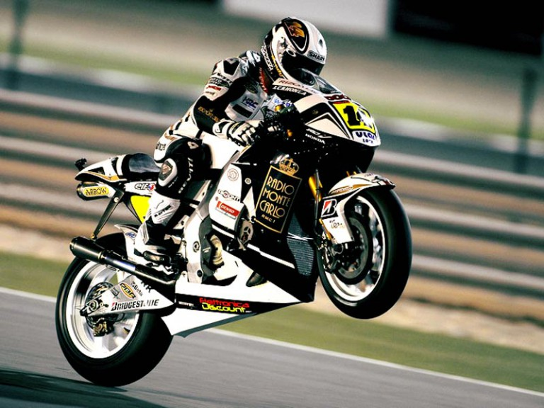 Randy de Puniet pulls off a wheelie in Qatar