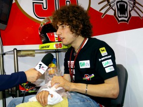 Marco Simoncelli in the Metis Gilera garage