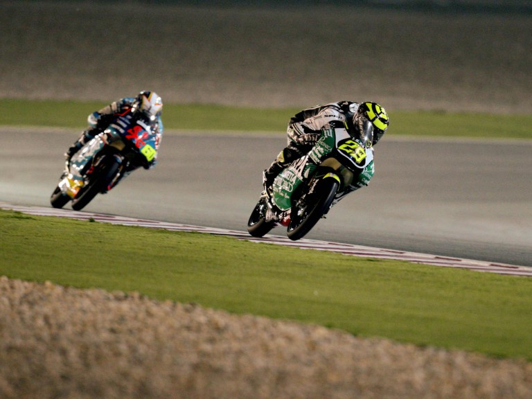 Andrea Iannone riding ahead of Julian Simon during 125cc race in Qatar