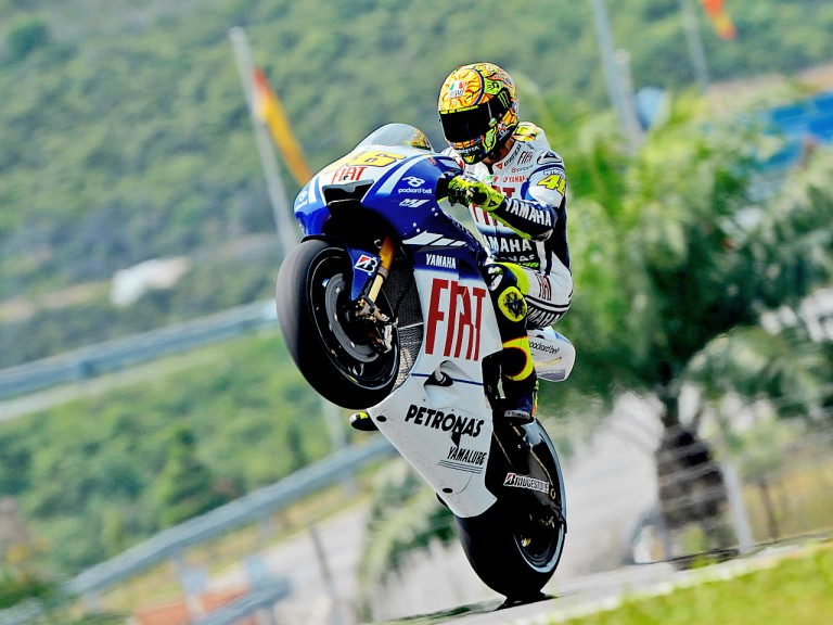Valentino Rossi pulls off a wheelie in Sepang