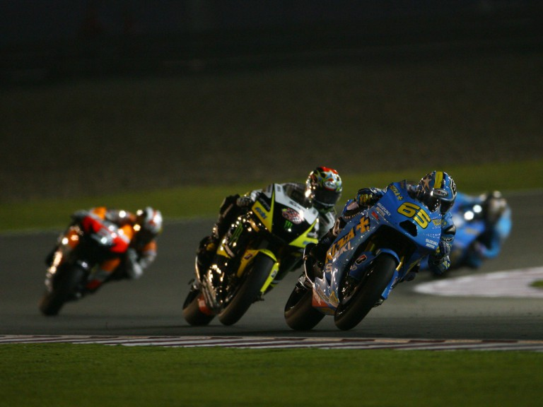 Capirossi ahead of Edwards in the early stages of the race at Losail