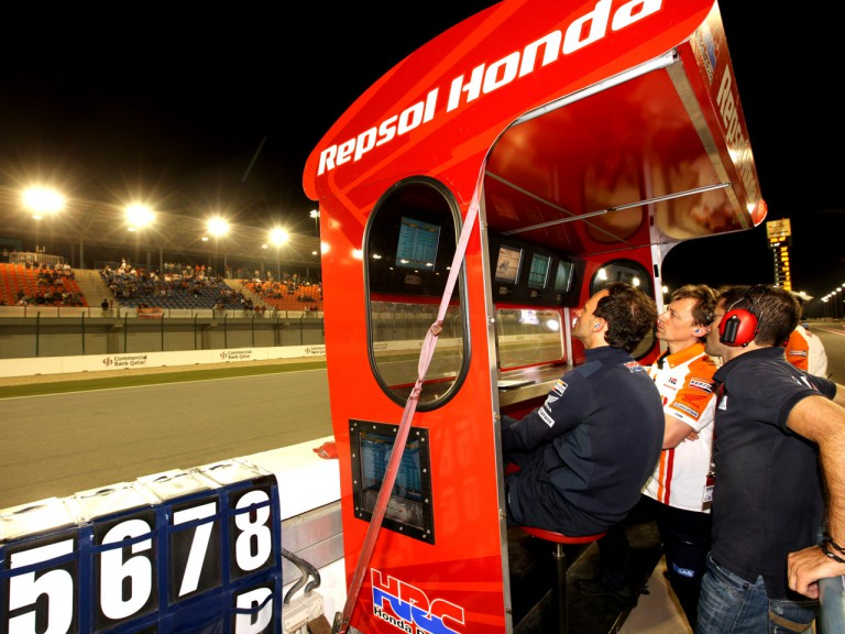 Alberto Puig, Raul Jara and Mike Leitner in the Repsol Honda pit wall during the race in Qatar