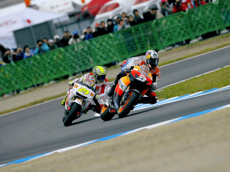 Dani Pedrosa riding ahead of Toni Elias in Motegi