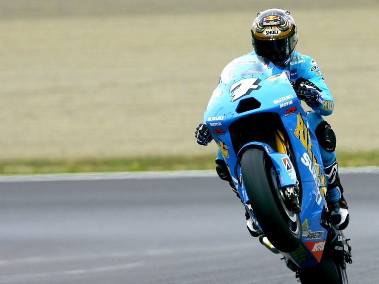 Chris Vermeulen pulls off a wheelie in Motegi