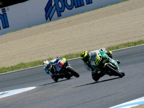 Andrea Iannone riding ahead of Julian Simon during 125cc race in Motegi