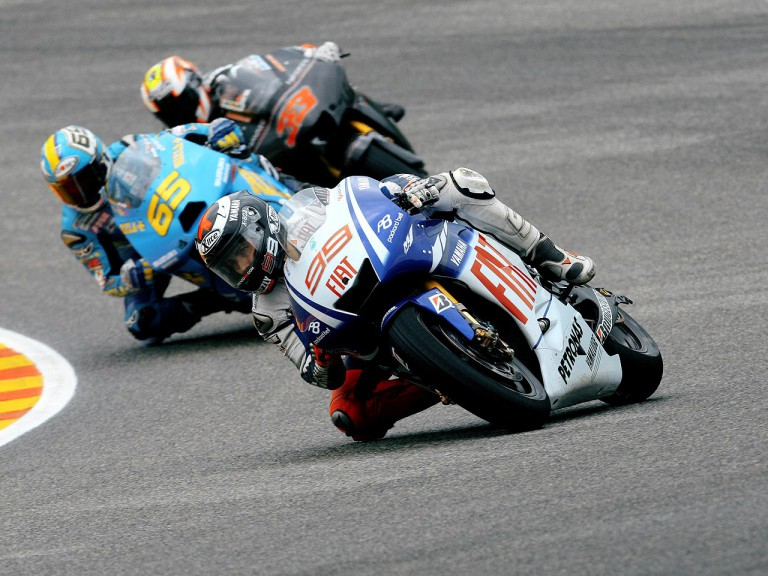 Jorge Lorenzo riding ahead of Capirossi and Melandri in Mugello