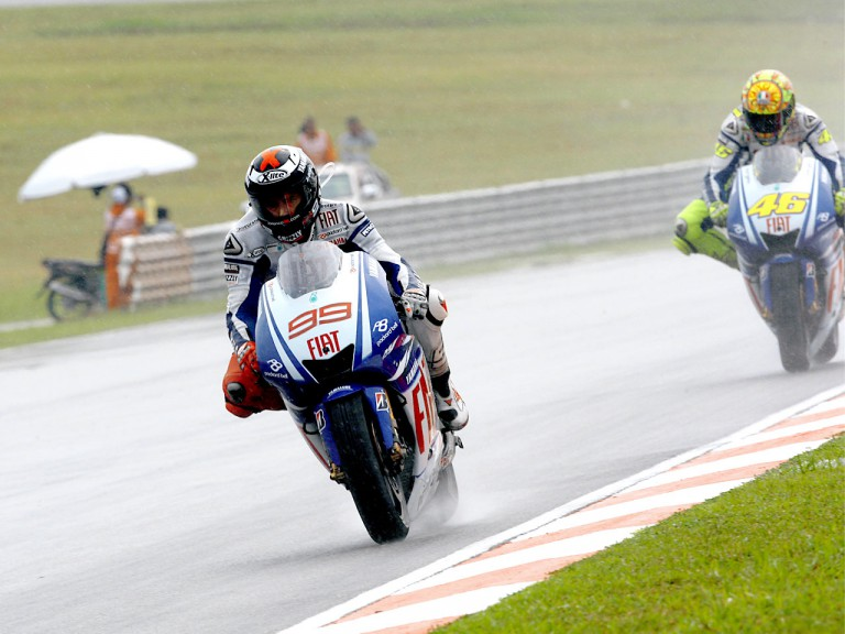 Lorenzo riding ahead of Rossi in Sepang