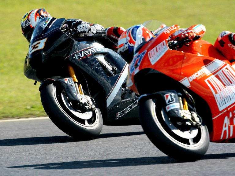 Casey Stoner and Marco Melandri riding side-by-side at MotoGP race in Motegi