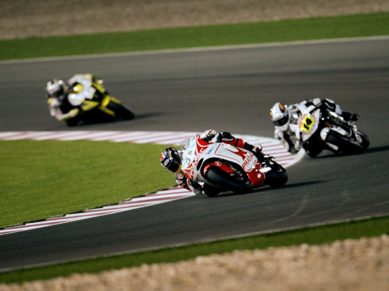 Mika Kallio riding ahead of Randy de Puniet  in Qatar
