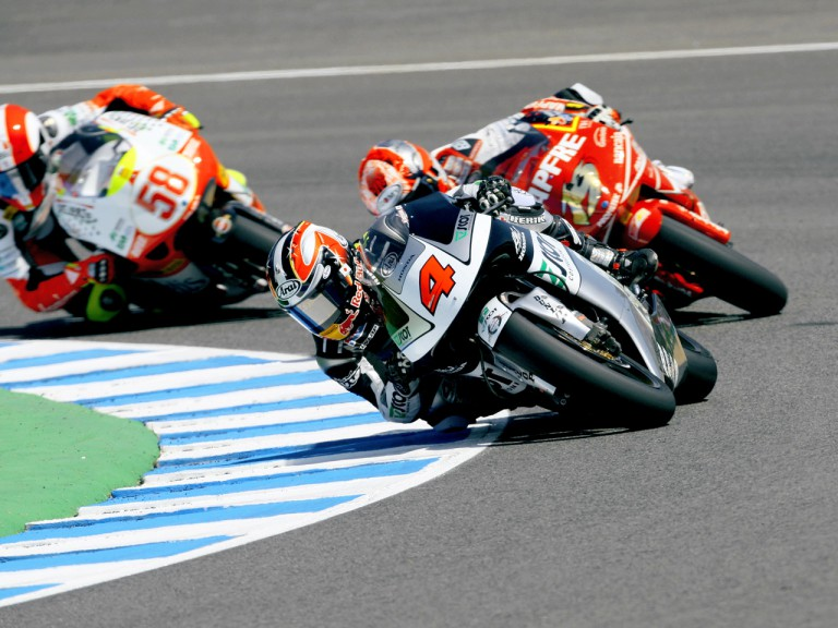 Hiroshi Aoyama riding ahead of Alvaro Bautista and Marco Simoncelli during 250cc race in jerez