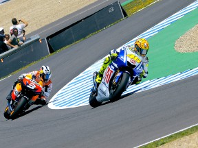 Valentino Rossi riding ahead of Dani Pedrosa during MotoGP race in Jerez