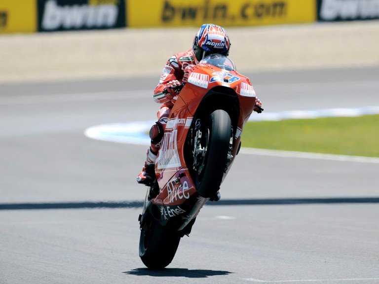 Casey Stoner pulls off a wheelie after the race in Jerez