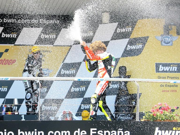 Hiroshi Aoyama and Marco Simoncelli on the podium at Jerez