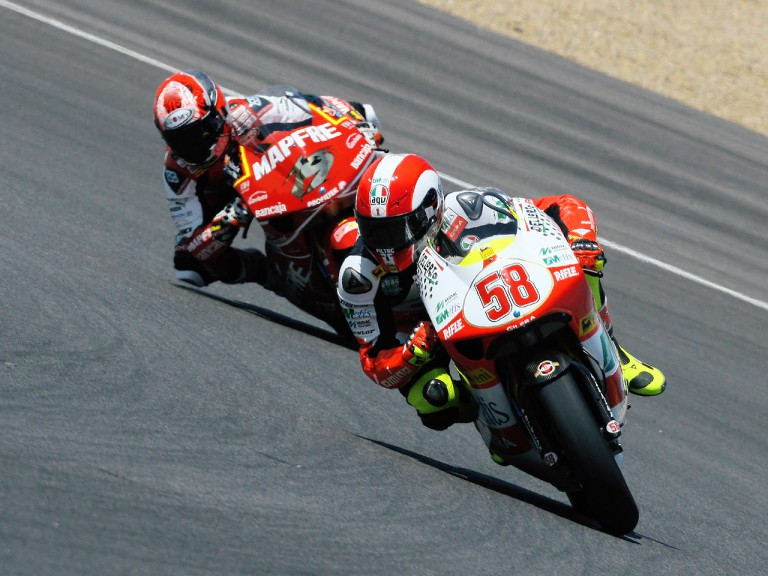 Marco Simoncelli and Alvaro Bautista in action in Jerez