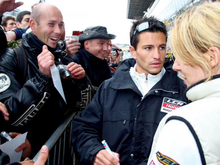 Randy de Puniet signing autographs at Le Mans Circuit