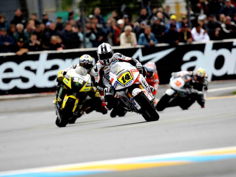 Randy de Puniet riding ahead of MotoGP group in Le Mans