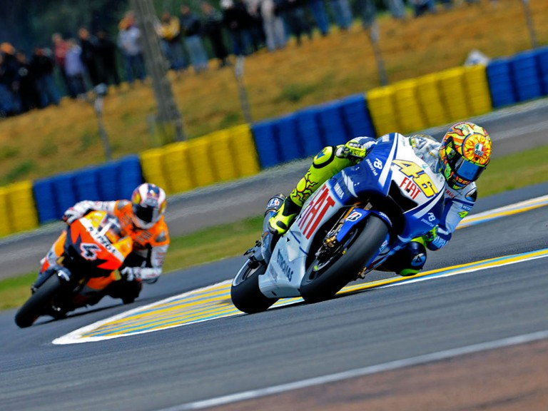 Valentino Rossi riding ahead of Andrea Dovizioso in Le Mans