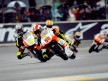 Marco Simoncelli riding ahead of 250cc group in Le Mans