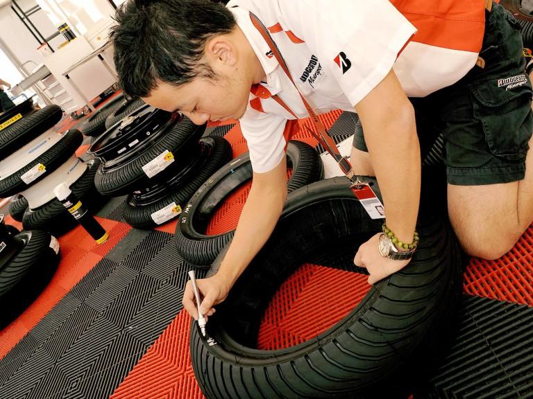 Bridgestone technician marking tyres