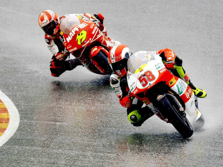 Marco Simoncelli riding ahead of Alvaro Bautista during 250cc race in Mugello