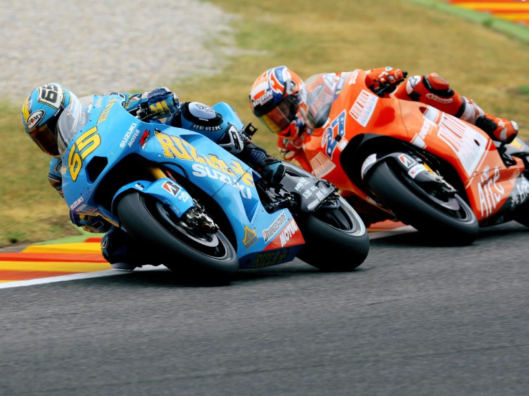 Loris Capirossi riding ahead of Casey Stoner in Mugello