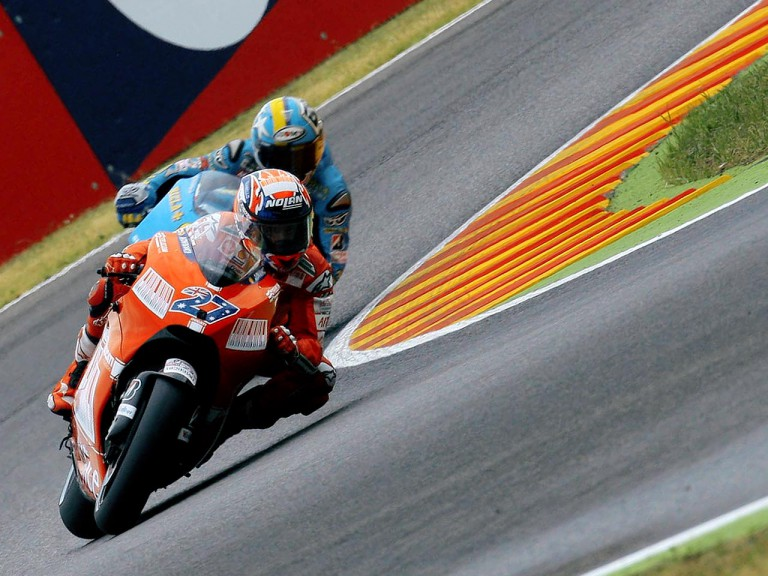 Casey Stoner riding ahead of Loris Capirossi in Mugello