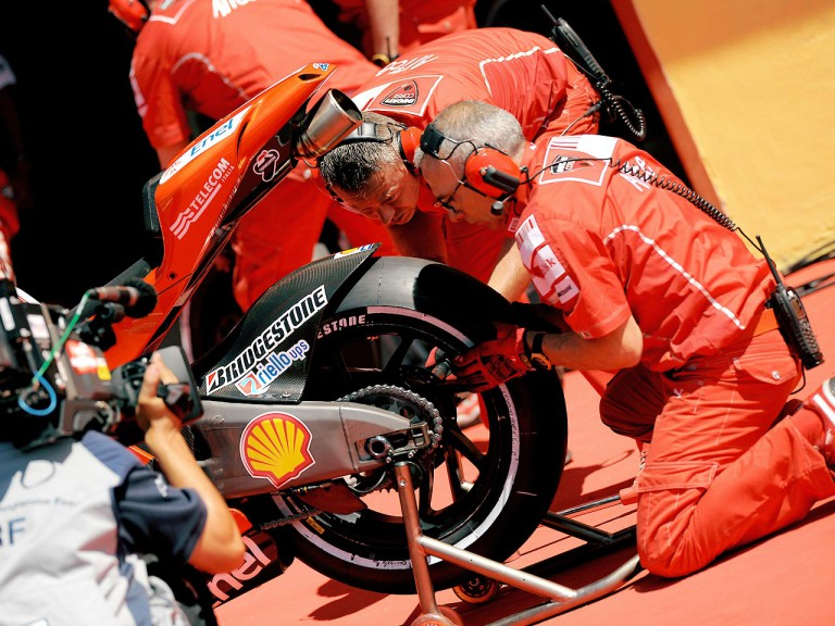 Ducati mechanics mounting Bridgestone rear tyre