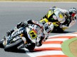 Randy de Puniet riding ahead Colin Edwards in Montmeló