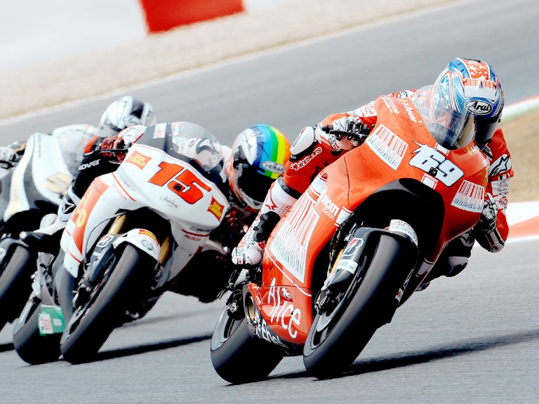 Nicky Hayden riding ahead of MotoGP group in Montmeló