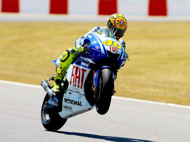 Valentino Rossi pulls off a wheelie in Montmeló