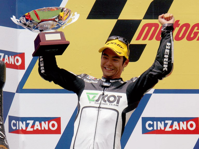 Hiroshi aoyama on the podium at Montmeló