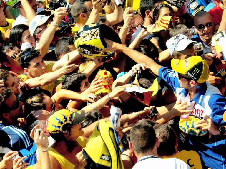Yamaha rider Valentino Rossi attending fans at Catalunya Circuit
