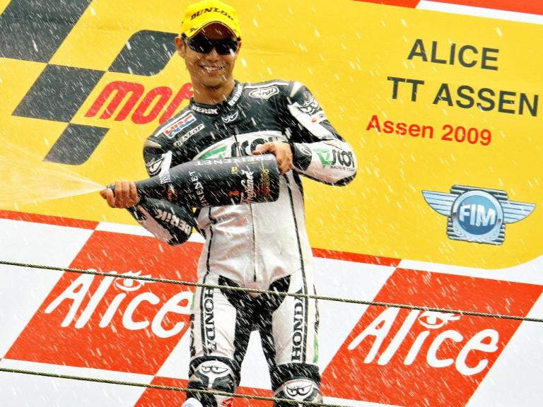 Hiroshi Aoyama on the podium at Assen