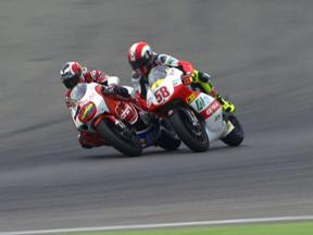 Hector Barbera and Marco Simoncelli during race in Assen