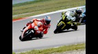 Nicky Hayden riding ahead of ames Toseland in Assen