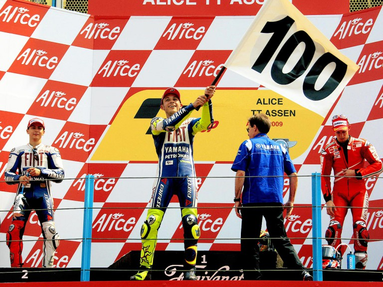 Valentino Rossi celebrates his 100th win on the podium in Assen