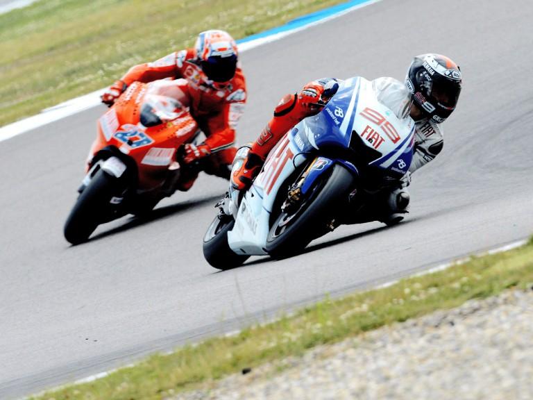 Jorge Lorenzo riding ahead of Casey Stoner in Assen