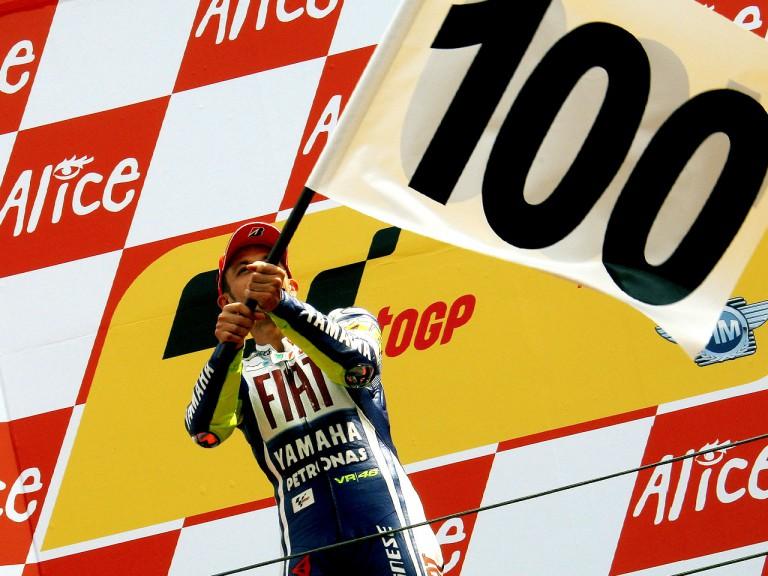 Valentino Rossi celebrates his 100th win on the podium in Assen