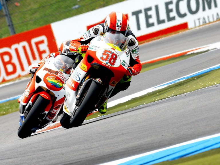 Marco Simoncelli riding ahead of Héctor Barberá in Assen